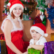 Little boy and mother in Santa hat — Stock Photo #7613174