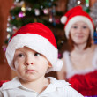 Little boy in Christmas hat — Stock Photo #7613177