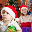 Boy sitting with Christmas gift — Stock Photo
