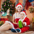 Woman and boy dressed like Santa Claus — Stock Photo