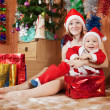 Boy  with mother  celebrating Christmas — Stock Photo