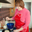 Woman cooking pancakes — Stock Photo #7613233