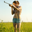 Girl with air rifle — Stock Photo #7613277