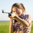 Stock Photo: Aiming girl