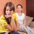 Stock Photo: Teenager daughter and mother after quarrel