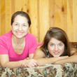 Mother and  daughter  resting on sofa - Stock Photo