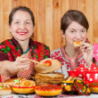 Women  eating pancake with caviare during  Shrovetide — Stock Photo