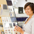 Young woman at cosmetics shop — Stock Photo