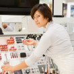 Girl at cosmetics shop — Stock Photo #7613320
