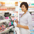 Woman at cosmetics shop — Stock Photo #7613324