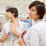 Woman at cosmetics shop — Stock Photo #7613333