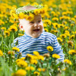 Little baby in flowers chaplet — Stock Photo