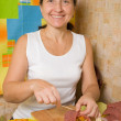 Royalty-Free Stock Photo: Woman sewed  stuffed beef by toothpicks