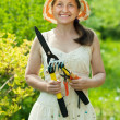 Foto Stock: Gardening mature woman