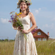Mature woman  in summer field — Stock Photo