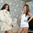 Woman make boast of fur coat — Stock Photo #7613583