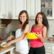 Two women cooking at kitchen — Стоковое фото