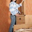 Happy girl dusting at home — Stock Photo #7613603