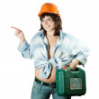 Stock Photo: Girl in hard hat pointing away