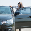 Woman with her car at road - Stockfoto