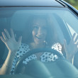 Fright woman in car — Stock Photo