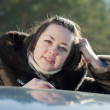 Woman near her car in winter - Stockfoto