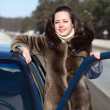 Happy woman with  car - Stockfoto