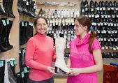 Women chooses high shoe — Stock Photo