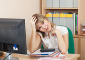 Weariness woman in office — Stock Photo