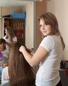 Hair stylist work on woman hair — Stock Photo