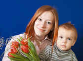 Mother with her son over blue — Stock Photo