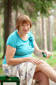 Woman embrocating jel in knee — Stock Photo