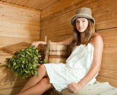 Girl relaxing in sauna — Stock Photo