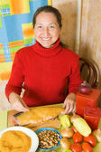 Woman is breading fish — Stock Photo