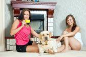 Women with labrador retriever — Stock Photo