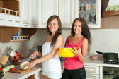 Two women cooking at kitchen — Stock Photo