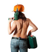 Topless girl in hardhat with drill — Stock Photo