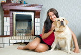 Woman with Labrador retriever — Photo