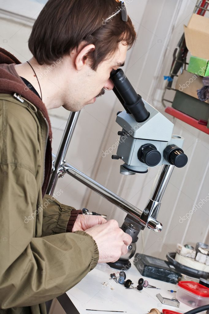 Jeweller is working with  microscope at jeweller's workshop — Stock Photo #7611325