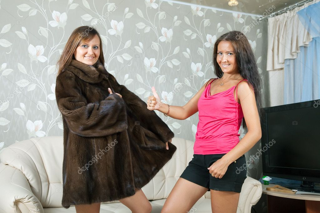 Woman shows new fur coat to friend — Stock Photo #7613584