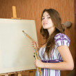 Stock Photo: Young painter near easel