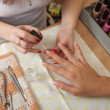 Foto Stock: Manicurist working with nails