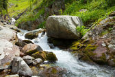 Waterfall in rocky mountains — Stock Photo