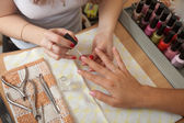 Manicurist working with nails — Foto Stock