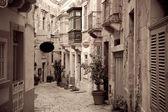 Retro photo of ctreet in old European town — Stock Photo