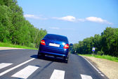 Blue car on the road — Stock Photo