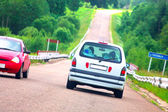 Cars on a dangerous bend — Stock Photo