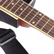 Foto Stock: Isolated guitar fingerboard and belt