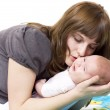 The woman communicates with the baby — Stock Photo