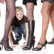 Boy amongst feminine legs — Stock Photo